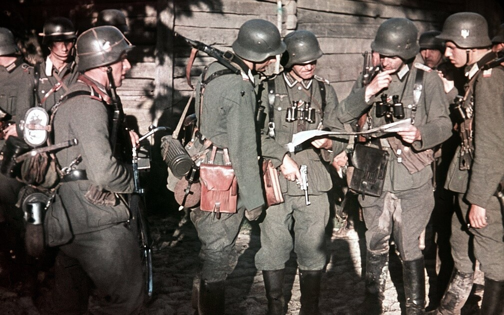 german troops are studying a map in world war 2
